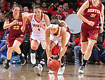 SIOUX FALLS, SD - MARCH 5:  Kelly Steward #15 of South Dakota picks up the ball followed by Tia Hemiller #4 of South Dakota and Paige Bradley #22 and Tori Bryant #332 of Denver.  (Photo by Dick Carlson/Inertia)