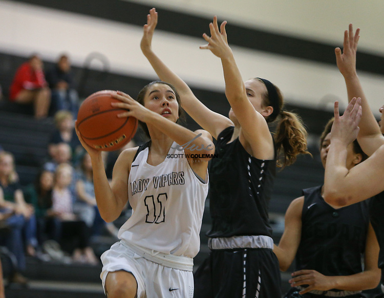 Vandegrift Vipers guard Autumn Howell (11) looks to shoot during a girls high school basketball game between the Vandegrift Vipers and the Cedar Park Timberwolves at Vandegrift High School in Austin, Texas on November 14, 2017.
