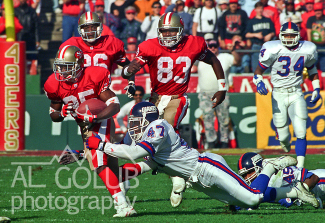 San Francisco 49ers vs. New York Giants at Candlestick Park Saturday, January 15, 1994.  49ers beat Giants 44-3.  New York Giants defensive back Greg Jackson (47) tackles San Francisco 49ers running back Dexter Carter (35).