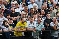 Leeds United fans watch on during the second half<br /> <br /> Photographer Alex Dodd/CameraSport<br /> <br /> Football Pre-Season Friendly - York City v Leeds United - Wednesday 10th July 2019 - Bootham Crescent - York<br /> <br /> World Copyright © 2019 CameraSport. All rights reserved. 43 Linden Ave. Countesthorpe. Leicester. England. LE8 5PG - Tel: +44 (0) 116 277 4147 - admin@camerasport.com - www.camerasport.com