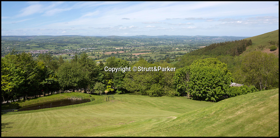 BNPS.co.uk (01202 558833)<br /> Pic: Strutt&Parker/BNPS<br /> <br /> Far reaching views over north Wales.<br /> <br /> Every man's home is his castle - but one lucky buyer could get their hands on this modern fortress complete with tower and fire-breathing dragon for a whopping £4 million.<br /> <br /> From the outside Castell Gyrn, which sits in the rolling countryside in Denbighshire, North Wales, looks the part of a 200-year-old citadel, but it is actually one of the country's youngest castles at just 39 years old.<br /> <br /> Unlike its ancient counterparts, the contemporary stronghold comes complete with draught exclusion, underfloor heating and double glazing.<br /> <br /> It also has the modern comforts of a cinema room, a library and a butler's pantry, as well as permission to add an extension for leisure facilities including an infinity swimming pool.