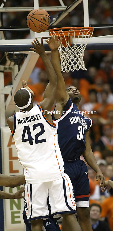 SYRACUSE, NY 16 JANUARY 2005 011605BZ15-      UConn #31, Rashad Anderson blocks a shot by Syracuse #42, Louie McCroskey<br /> <br /> during their game at the carrier Dome at Syracuse University Monday night. <br /> Jamison C. Bazinet Republican-American