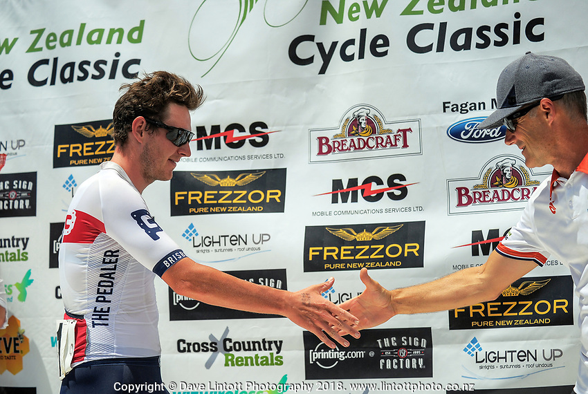 Brisbane Continental's Jordan Kerby shakes hands with tour announcer Del Woodford after winning stage five of the 2018 NZ Cycle Classic UCI Oceania Tour (Masterton criterium) in Masterton, New Zealand on Friday, 21 January 2018. Photo: Dave Lintott / lintottphoto.co.nz