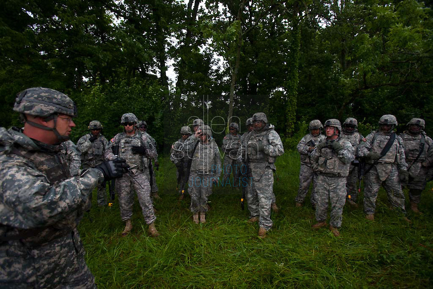 "Members of the Georgia Army National Guard's 48th Brigade, 148th Brigade Support Battalion, undergo an ""after-action review"" following an attack and medical evacuation scenario during a media visit day at Camp Atterbury, Indiana on Wednesday, June 3, 2009. The review allows a discussion of how the unit reacted correctly or incorrectly in dealing with the surprise firefight. The brigade's upcoming overseas mission is to train the Afghan National Army and Police forces."