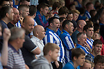 A supporter of Hartlepool United yawning during the first-half at the Victoria Ground, Hartlepool, during a pre-season friendly between the home team and Middlesbrough. Hartlepool were relegated to League Two at the end of the 2012-13 season whilst their Teesside neighbours remained two divisions above them in the Championship. The game ended in a no-score draw, the home team's goalkeeper Scott Flinders saving a second-half penalty from Boro's Lucas Jutkiewicz, watched by a crowd of 2307.