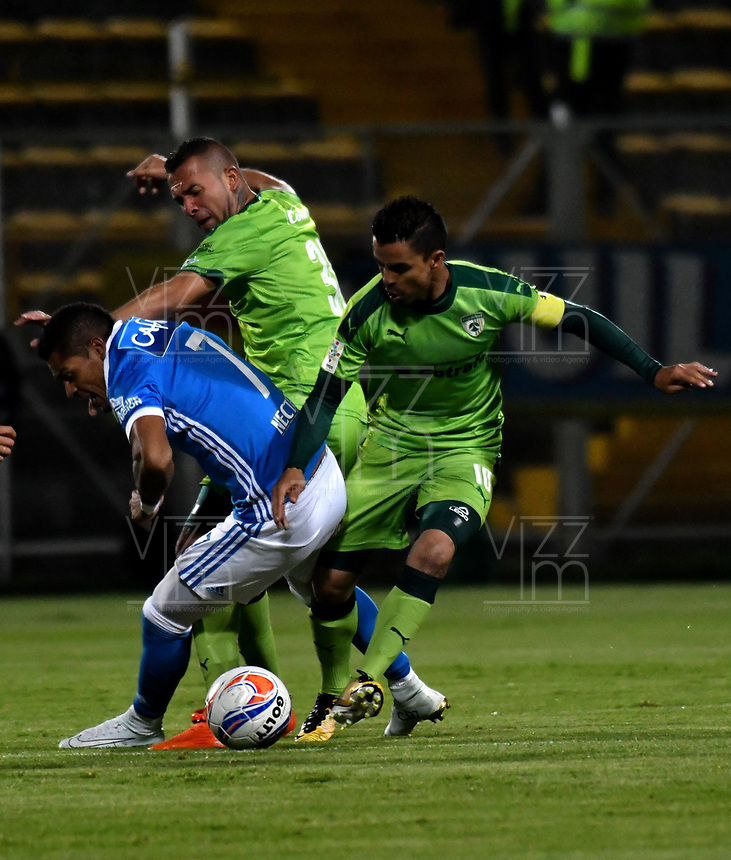 BOGOTA - COLOMBIA -25 - 11 - 2017: Stalin Motta (Der.) y Andres Correa (Cent.) jugadores de La Equidad disputan el balón con Ayron del Valle (Izq.) jugador de Millonarios, durante partido de ida entre La Equidad y Millonarios, de los cuartos de final la Liga Aguila II - 2017, jugado en el estadio Metropolitano de Techo de la ciudad de Bogota. / Stalin Motta (R) and Andres Correa (C) players of La Equidad vie for the ball with Ayron del Valle (L) player of Millonarios, during a match for the first leg between La Equidad and Millonarios, to the quarter of finals for the Liga Aguila II - 2017 at the Metropolitano de Techo Stadium in Bogota city, Photo: VizzorImage  / Luis Ramirez / Staff.