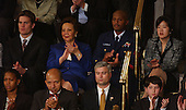 """Honored guests in the first lady's box for the State of the Union Address 2004.  From left to right: Tom Brady, Quarterback, New England Patriots; Mrs. Alma Powell, wife of United States Secretary of State Colin Powell; Coast Guard Gunnersmate First Class Daniel """"Tree or Guns""""  Christopher Roundtree, Bronx, New York.  Gunnersmate First Class Roundtree is stationed in the Coast Guard Group, Miami Armory.  He has served for ten years.  He returned from Bahrain in August 2003. His wife, Michelle, is also in the Coast Guard;  Michelle Rhee, President and CEO, New Teacher Project, New York, New York (Note: Mrs. Rhee lives in Sylvania, Ohio), Michelle Rhee serves as Chief Executive Officer and President of The New Teacher Project.  A non-profit organization, the New Teacher Project partners with school districts, state departments of education, and other educational<br /> entities to enhance their capacity to recruit, select, train, and support outstanding new teachers for difficult-to-staff schools.  Since its inception in 1997, The New Teacher Project has launched 39 programs in 18 states and attracted and prepared over 10,000 new, high-quality teachers. Mrs. Rhee holds a bachelor's degree in Government from Cornell University and a master's degree in Public Policy from the Kennedy School of Government at Harvard University.<br /> Credit: Ron Sachs / CNP"""