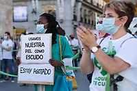 MADRID, SPAIN - JUNE 29: A woman holds a placard during a protest held in the afternoon in Puerta del Sol to request better working conditions, protection equipment and investment in Health to fight against the covid-19 on June 29 2020, in Madrid, Spain. The region of Madrid was the main focus of covid-19 outbreak in Spain. In al over the country, more than 50000 thousand health staff has been infected with the coronavirus since the beginning of the pandemic.(Photo by Sergio Belena/VIEWpress via Getty Images).