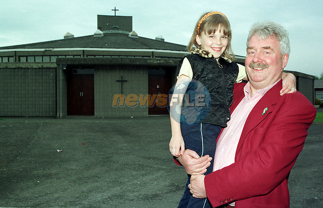 Newrly one year on the News of the World Brings Larry O'Toole back to the scene where he was shot during his grand daughter Laura O'Toole's  First Communion at the CHurch in Ballymun..Pic Fran Caffrey / Newsfile