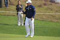 Richie Ramsay (SCO) sinks his putt on the 5th green during Sunday's Final Round of the 2014 BMW Masters held at Lake Malaren, Shanghai, China. 2nd November 2014.<br /> Picture: Eoin Clarke www.golffile.ie