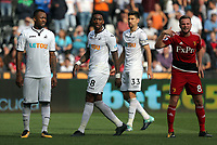 (L-R) Jordan Ayew, Leroy Fer, Federico Fernandez of Swansea City and Tom Cleverley of Watford during the Premier League match between Swansea City and Watford at The Liberty Stadium, Swansea, Wales, UK. Saturday 23 September 2017