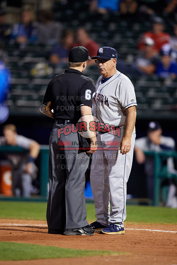 Colorado Springs Sky Sox manager Rick Sweet (16) talks with home plate umpire Nate White during a game against the Oklahoma City Dodgers on June 2, 2017 at Chickasaw Bricktown Ballpark in Oklahoma City, Oklahoma.  Colorado Springs defeated Oklahoma City 1-0 in ten innings.  (Mike Janes/Four Seam Images)