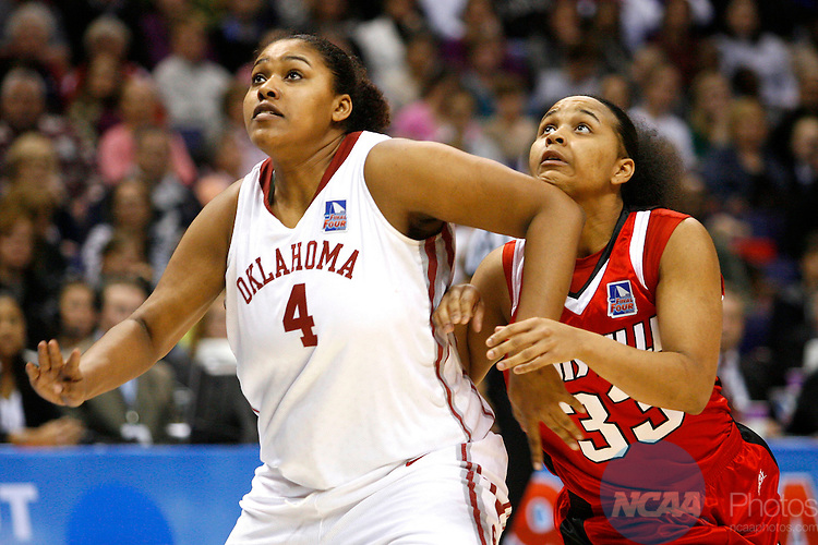 05 APR 2009:  Abi Olajuwan of Oklahoma (left) boxes out Monique Reid of Louisville during the Division I Women's Basketball Semifinals held at the Scottrade Center  in St. Louis, MO.  Louisville defeated Oklahoma 61-59.  Trevor Brown, Jr./NCAA Photos