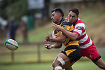 Sam Vaka gets the ball away as Ross Turnbull makes the tackle. Counties Manukau Premier Club Rugby game between Bombay and Karaka, played at Bombay, on Saturday March 15 2014. Karaka won the game 39 - 12 after leading 13 - 5 at halftime.  Photo by Richard Spranger