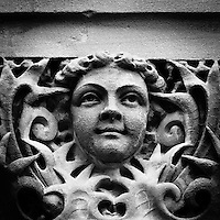 Ornately carved faces in stone around the courthouse building in Waxahachie, Texas.