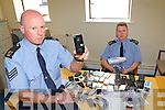 Sergeant Stephen O'Shea left and Garda Conor Farrell with the hoard of stolen mobile phones which was recovered after an investigation over the last few weeks in Killarney