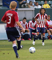 Chivas USA defender Jim Curtin (3) passes a ball to teammate Francisco Mendoza (6) gets. Chivas USA defeated the Santos of Laguna 1-0 during the 1st round of the 2008 SuperLiga at Home Depot Center stadium, in Carson, California on Wednesday, July 16, 2008.