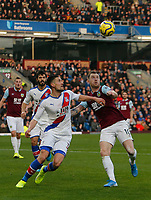 30th November 2019; Turf Moor, Burnley, Lanchashire, England; English Premier League Football, Burnley versus Crystal Palace; Martin Kelly of Crystal Palace and Ashley Barnes of Burnley wait for a high ball to drop into the Crystal Palace area - Strictly Editorial Use Only. No use with unauthorized audio, video, data, fixture lists, club/league logos or 'live' services. Online in-match use limited to 120 images, no video emulation. No use in betting, games or single club/league/player publications