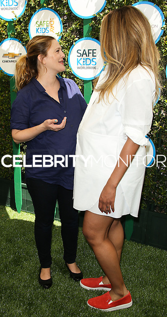 WEST HOLLYWOOD, CA, USA - APRIL 05: Drew Barrymore, Ciara at the Safe Kids Day Event 2014 -  Los Angeles held at The Lot on April 5, 2014 in West Hollywood, California, United States. (Photo by Celebrity Monitor)