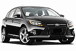 Low aggressive passenger side front three quarter view of a 2012 Ford Focus Hatchback Titanium Stock Photo