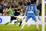 SANTANDER - SEPTEMBER 21:  Karim Benzema of Real Madrid (C) duels for the ball with Francisco Jesus Perez of Real Racing Club during the La Liga soccer match between Real Racing Club and Real Madrid at El Sardinero Stadium on September 21, 2011 in Santander, Spain. Photo by Victor Fraile / The Power of Sport Images