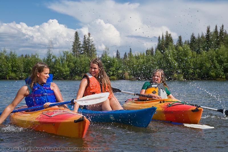 The Slater sisters kayaking on the Chena River, Fairbanks, Alaska.