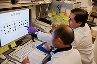 Dr. Dan Barouch (right) looks over recent data from Dr. Jinyan Liu's recent research on immune responses after antibody treatments in the Barouch Lab at Beth Israel Deaconess Medical Center and Harvard Medical School in Boston, Massachusetts, USA. Jinyan Liu is and MD PhD and staff scientist.<br /> <br /> Dr. Dan Barouch is Professor of Medicine and physician at Beth Israel Deaconess Medical Center and Harvard Medical School in Boston, Massachusetts, USA. He is director of the Barouch Lab at the Center for Virology and Vaccine Research at Beth Israel Deaconess Medical Center and has recently published research on the evaluation of novel antibody therapy for HIV infection.<br /> <br /> CREDIT: M. Scott Brauer for the Wall Street Journal<br /> AIDS