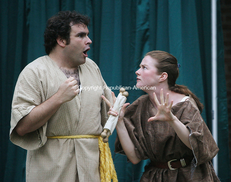 WATERBURY, CT 30 June 2005 -063005BZ04- Jason Collins, as &quot;Bottom&quot;, left, and Lissa Romaine, as&quot;Quince&quot; during a Shakesperience production of &quot;A Midsummer Night's Dream&quot; in library park in Waterbury Thursday night.  <br /> Jamison C. Bazinet Photo