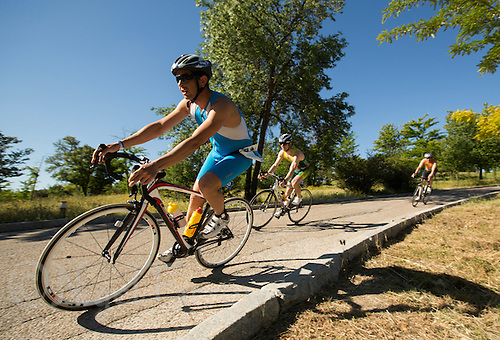 01 JUN 2013 - MADRID, ESP - Competitors make their way around the Casa de Campo cycle course in Madrid, Spain during the WTP Agemaster race (PHOTO (C) 2013 NIGEL FARROW)