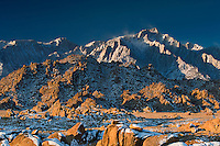 711700279 winter morning with snow covered granite boulders in the bureau of land management protected land the alabama hills in the southern section of the eastern sierras with lone pine peak in the background in kern county california