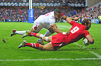 Wales's William Harries scores his sides second try under pressure from England's Marcus Watson<br /> <br /> Wales Vs England - men's classification 5th - 6th place match<br /> <br /> Photographer Chris Vaughan/CameraSport<br /> <br /> 20th Commonwealth Games - Day 4 - Sunday 27th July 2014 - Rugby Sevens - Ibrox Stadium - Glasgow - UK<br /> <br /> © CameraSport - 43 Linden Ave. Countesthorpe. Leicester. England. LE8 5PG - Tel: +44 (0) 116 277 4147 - admin@camerasport.com - www.camerasport.com