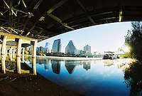 Austin, Texas downtown city skyline under bridge as steam rises on winter morning on Townlake in Austin, Texas, USA