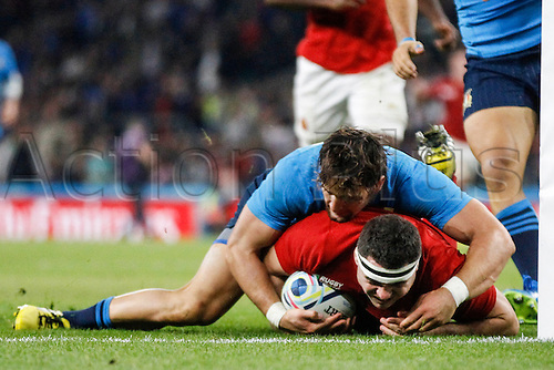 19.09.2015. Twickenham, London, England. Rugby World Cup. France versus Italy.  Michele Campagnaro of Italy stops Guilhem Guirado of France just short of the line.   Final score: France 32-10 Italy.