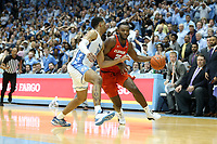 CHAPEL HILL, NC - JANUARY 11: Aamir Simms #25 of Clemson University is guarded by Garrison Brooks #15 of the University of North Carolina during a game between Clemson and North Carolina at Dean E. Smith Center on January 11, 2020 in Chapel Hill, North Carolina.
