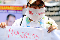 Mexico City, DF May 10, 2014. A woman takes part of a march to demand the government to search and locate their missing children. During the third National March for Dignity.  Miguel Angel Pantaleon/VIEWpress