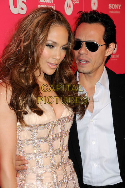 JENNIFER LOPEZ & MARC ANTHONY.US Weekly Hot Hollywood Style Issue Event held at Drai's at the W Hollywood Hotel, Hollywood, California, USA..April 22nd, 2010.half length dress j-lo pink diamante sparkly black suit jacket blue shirt sunglasses shades married husband wife blue shirt mouth open looks bored tired funny .CAP/ADM/BP.©Byron Purvis/AdMedia/Capital Pictures.