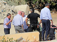 Pictured: Eddie Needham (3rd L), the grandfather of missing Ben Needham with DI Jon Cousins of South Yorkshire Police (2nd L) and other officers in Kos, Greece. Wednesday 05 October 2016<br />