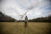 Chatham County Commissioner Tom Vanderbeck seeks out a wireless signal in a pasture near his home near Pittsboro, NC, Wed., Feb. 11, 2009..