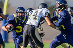 Santa Monica, CA 10/17/13 - unidentified Santa Monica player(s) and Paxton Shive (Peninsula #24) in action during the Peninsula vs Santa Monica Junior Varsity football game at Santa Monica High School.