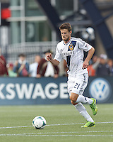LA Galaxy defender Tommy Meyer (21) brings the ball forward.  In a Major League Soccer (MLS) match, the New England Revolution (blue) defeated LA Galaxy (white), 5-0, at Gillette Stadium on June 2, 2013.
