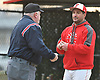 Roberto Delgado, Freeport varsity baseball head coach, has a discussion with the home plate umpire during a non-league game against Bellmore JFK at Cleveland Avenue Field in Freeport on Friday, March 24, 2017. Freeport won by a score of 9-6.