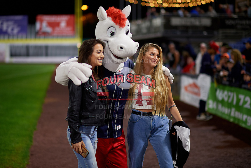 Binghamton Rumble Ponies mascot Rowdy the Pony poses for a photo with two fans during a game against the Portland Sea Dogs on August 31, 2018 at NYSEG Stadium in Binghamton, New York.  Portland defeated Binghamton 4-1.  (Mike Janes/Four Seam Images)