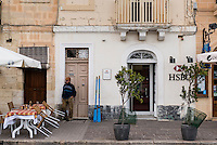 Malta, 29 December 2014<br /> <br /> In the fishing village of Marsaxlokk, south east of Valetta. Here a local fisherman in front of the local HSBC bank.<br /> Photo Kees Metselaar