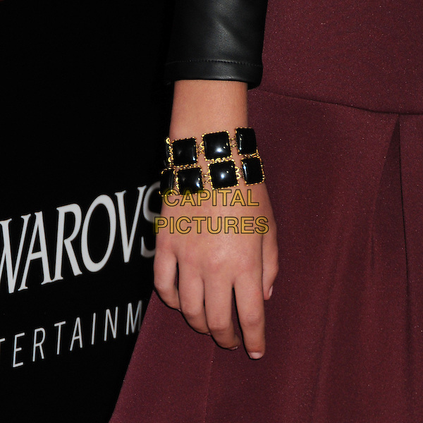 Bailee Madison's hand<br /> &quot;Romeo &amp; Juliet&quot; Los Angeles Premiere held at Arclight Cinemas, Hollywood, California, USA.<br /> September 24th, 2013<br /> detail hand maroon burgundy black bracelets jewellery jewelry<br /> CAP/ADM/BP<br /> &copy;Byron Purvis/AdMedia/Capital Pictures