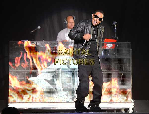 LUDACRIS (Chris Bridges).performs live at Staples Center in Los Angeles, California, USA,.March 29th, 2010    .music gig concert live on stage .full length hand sunglasses microphone black leather jacket trousers wrist watch   trainers ring hand necklace mouth open smiling                                                             .CAP/RKE/DVS.©DVS/RockinExposures/Capital Pictures.