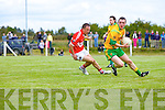 Gneeveguilla's Padraig O'Riordan side steps Daithi O Geibheannaigh of Dingle last Sunday afternoon in Gneeveguilla for round 2 of the Garvey's Supervalue County Senior Championship.