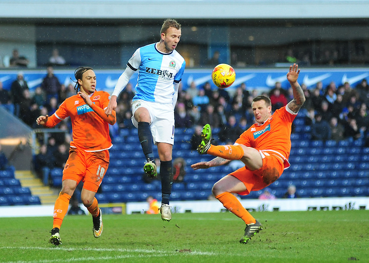 Blackburn Rovers' Jordan Rhodes challenges for a boiuncing ball with Blackpool's Grant Hall (right) and Blackpool's Charles Dunne (left)<br /> <br /> Photographer Andrew Vaughan/CameraSport<br /> <br /> Football - The Football League Sky Bet Championship - Blackburn Rovers v Blackpool - Saturday 21st February 2015 - Ewood Park - Blackburn<br /> <br /> &copy; CameraSport - 43 Linden Ave. Countesthorpe. Leicester. England. LE8 5PG - Tel: +44 (0) 116 277 4147 - admin@camerasport.com - www.camerasport.com