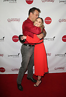 """LOS ANGELES, CA - NOVEMBER 7: Adam Mayfield, Kelley Jakle, at Premiere of Lifetime's """"Christmas Harmony"""" at Harmony Gold Theatre in Los Angeles, California on November 7, 2018. Credit: Faye Sadou/MediaPunch"""