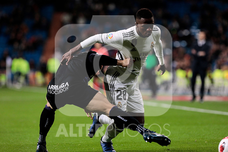 Real Madrid's Vinicius Jr. and CD Leganes's Unai Bustinza during Copa Del Rey match between Real Madrid and CD Leganes at Santiago Bernabeu Stadium in Madrid, Spain. January 09, 2019. (ALTERPHOTOS/A. Perez Meca)