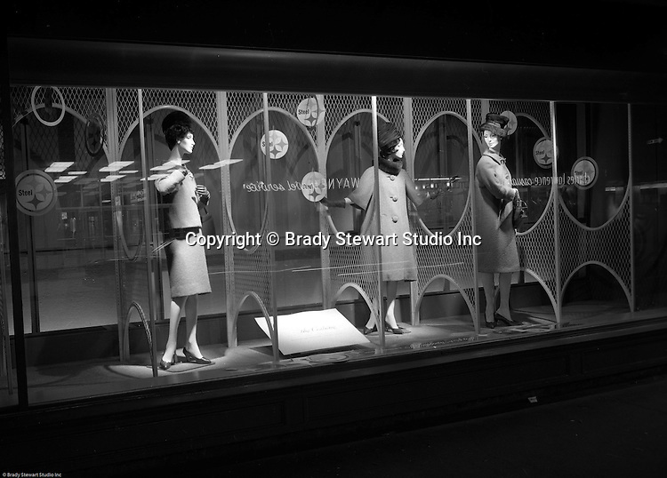 Pittsburgh PA: View of Christmas window display at Horne's department store in downtown Pittsburgh. Women dressed up for the season surrounded by a steel display during the Rhapsody of Steel campaign. US Steel launched an awareness campaign of all the current uses of steel in everyday products.  During this time, ALCOA Aluminum Company of America also headquartered in Pittsburgh, was aggressively competing to enter markets where US  steel companies traditional dominated market share. Examples included beer and food Cans, appliances, automobile parts, children toys / bicycles, and more.